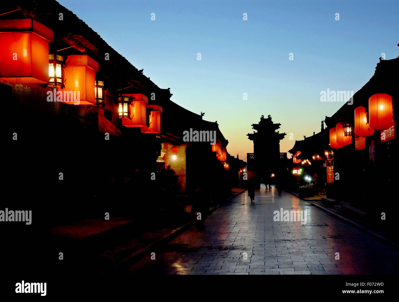 Beijing, China. 8th Dec, 2014. Photo taken on Dec. 8, 2014 shows the night view of Pingyao ancient city, north China's Stock Photo