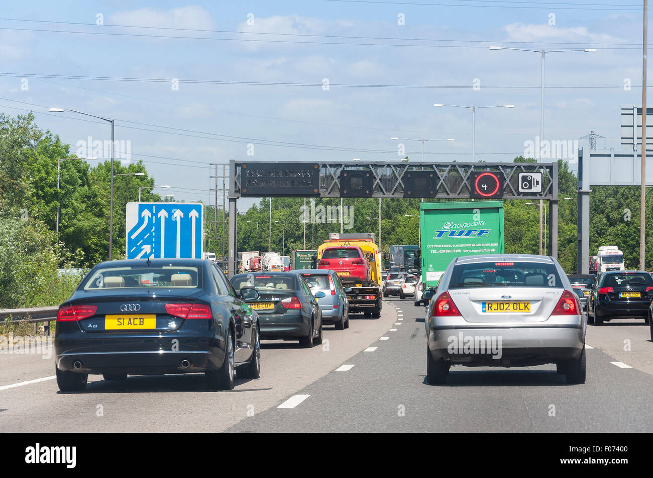 Traffic jam and speed restrictions on M25 Motorway, Surrey, England, United Kingdom - Stock Image