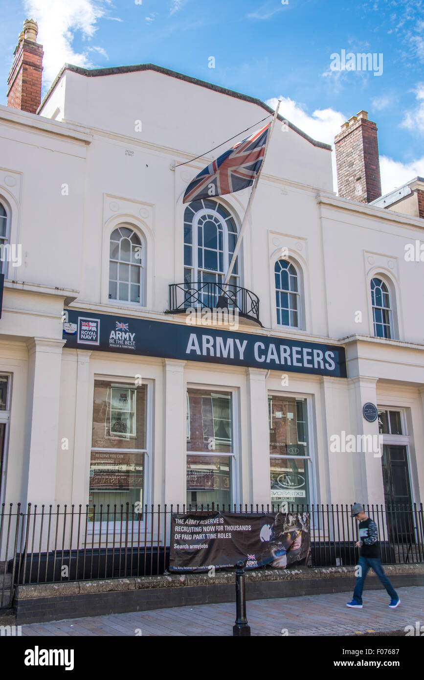 A young lad walking past the Army Careers Office in Wolverhampton UK - Stock Image