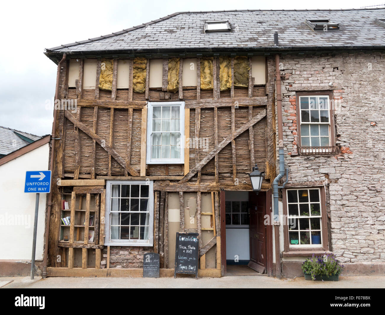 Cafe building in Hay-on-Wye Powys Wales with front facade exposed showing timber frame structure, wattle and daub - Stock Image