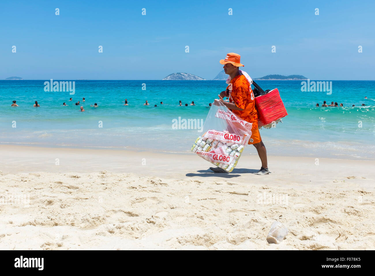 RIO DE JANEIRO, BRAZIL - MARCH 15, 2015: Brazilian vendor walks selling South American mate tea and Globo brand - Stock Image