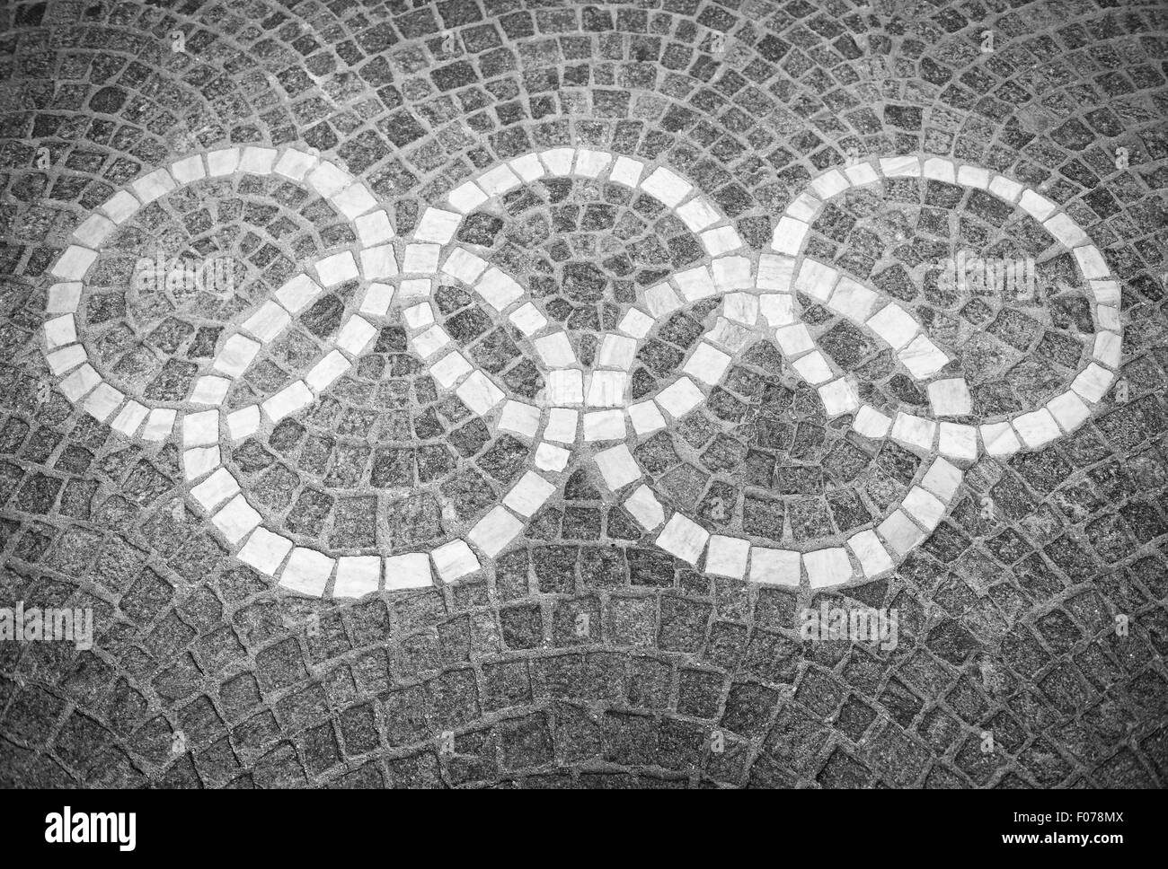 ROME, ITALY - JULY, 2012: Decorative Olympic rings logo set in stone blocks at the Foro Italico sports complex. - Stock Image