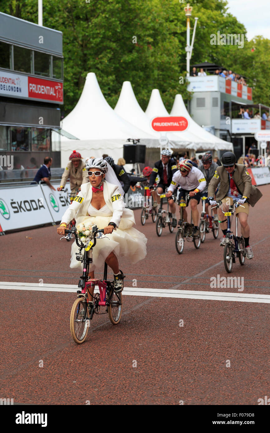 Monica Oliver, in bridalwear, during the 10th Brompton World Championships Final, part of Prudential RideLondon - Stock Image