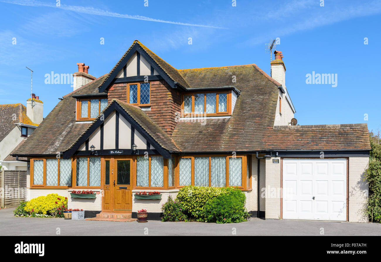 2 storey detached house in Mock Tudor style with double-glazed windows and a garage in West Sussex, England, UK. - Stock Image