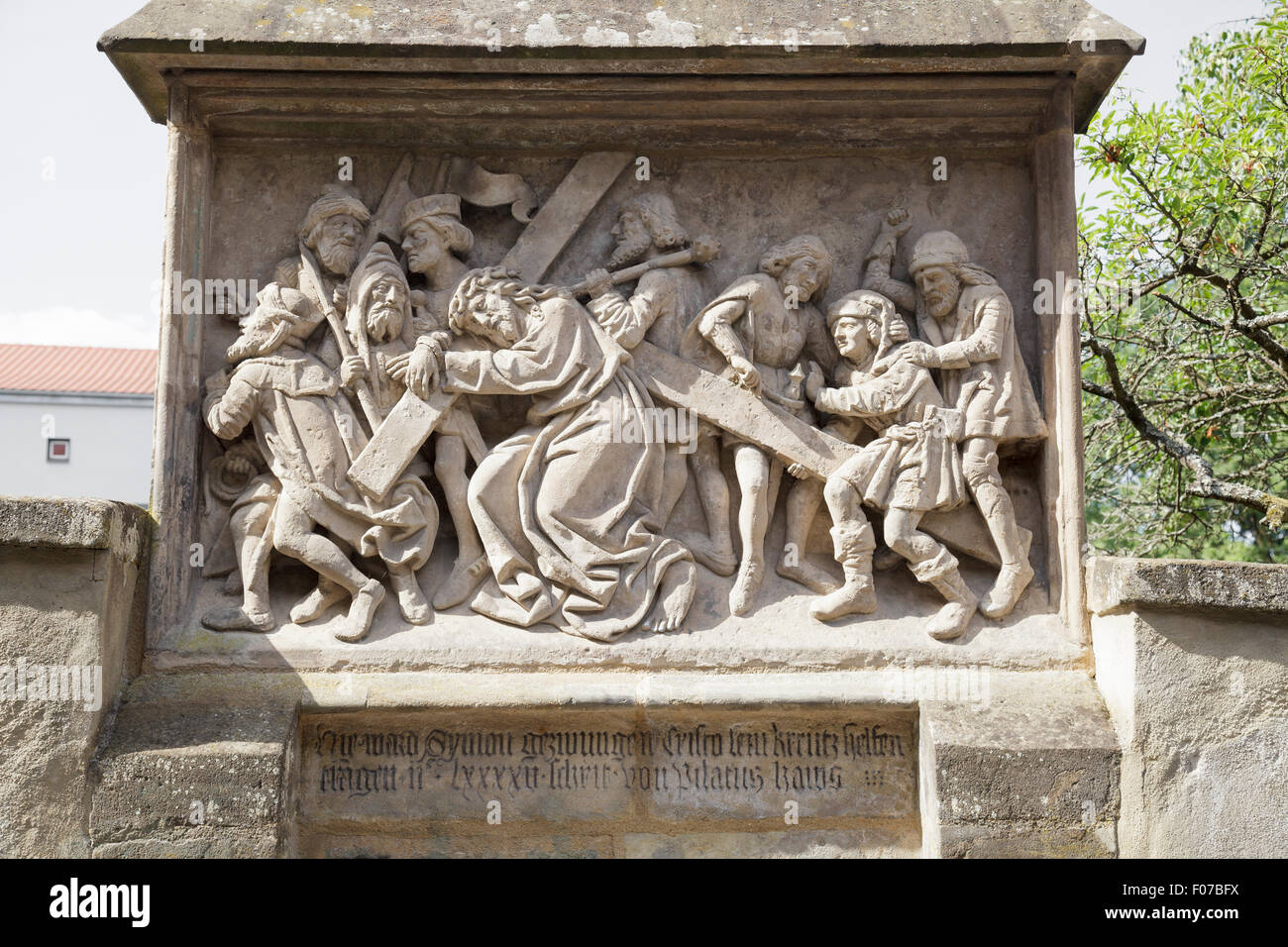 Stations of the Cross, from 1503, Simon of Cyrene helps Jesus to carry the Cross, Bamberg, Bavaria, Germany - Stock Image