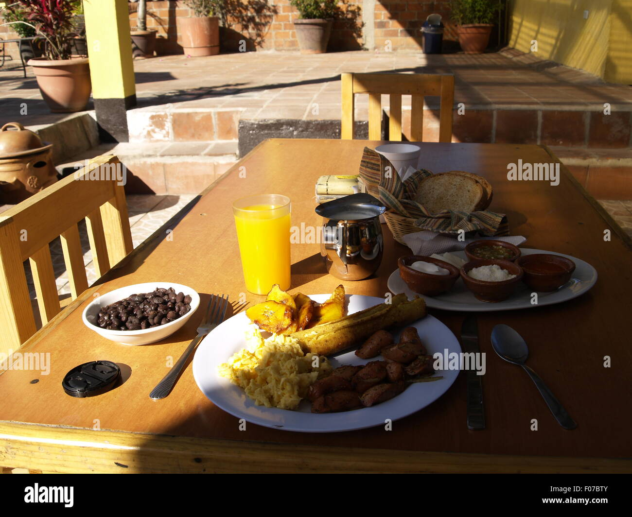 Traditional Guatemalan breakfast at a hostel in Antigua, Guatemala - Stock Image