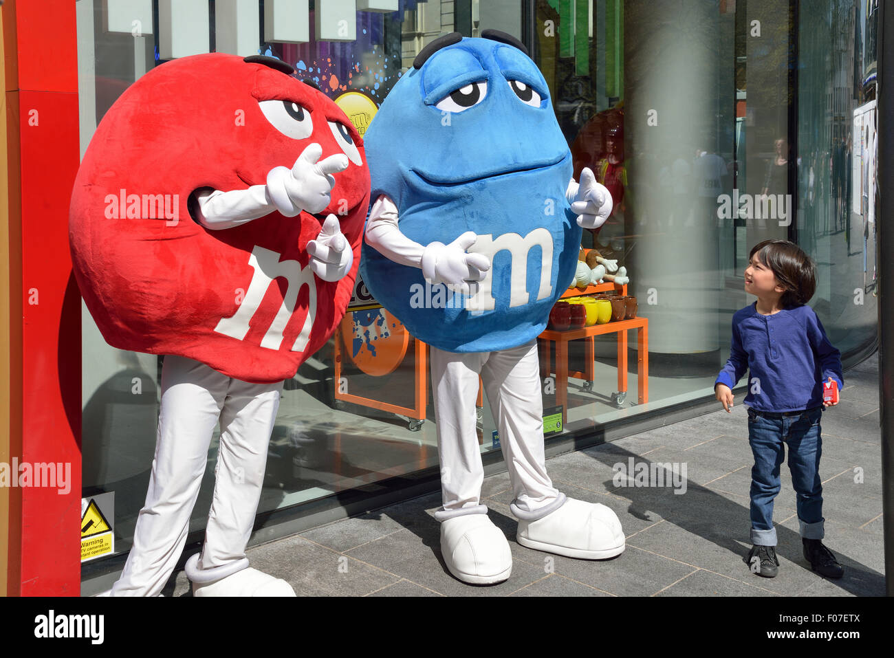Child with M&M characters outside M&M's World, Swiss Cottage, Leicester Square, West End, City of Westminster, - Stock Image
