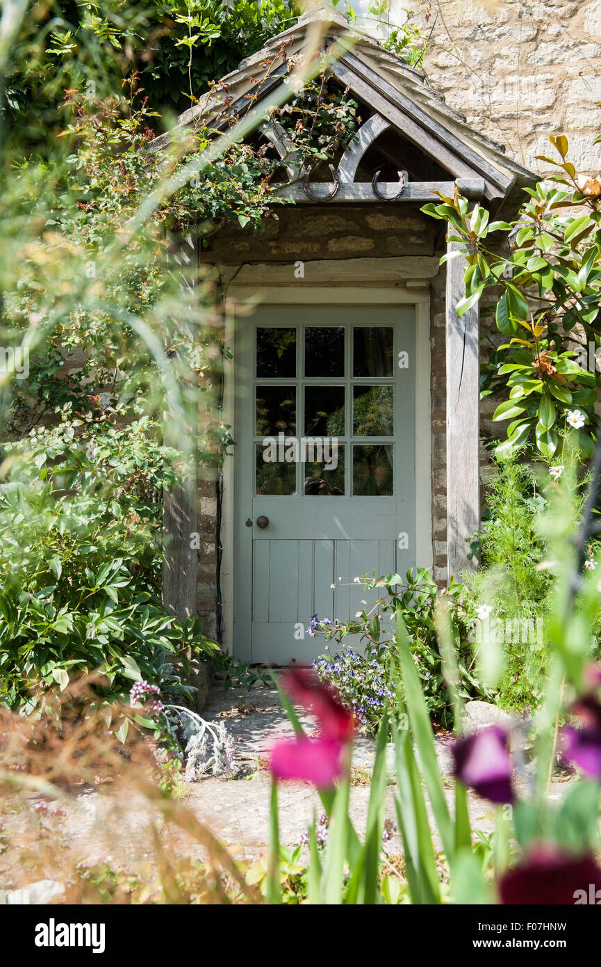 The Door Of A Quintessential English Country Cottage With Wild Stock