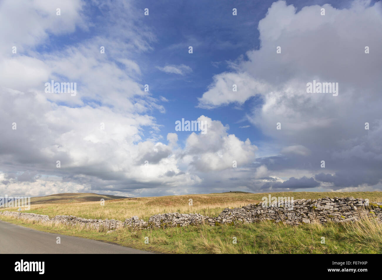 Summertime over the fells on a upland country road, Yorkshire Dales National Park, England, UK - Stock Image