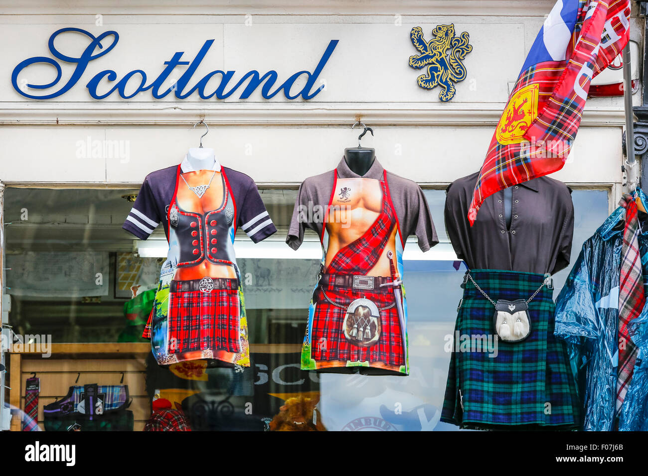 Outside displays of tartan styled cooking aprons, kilts and Scottish flags, Edinburgh, Scotland, UK - Stock Image