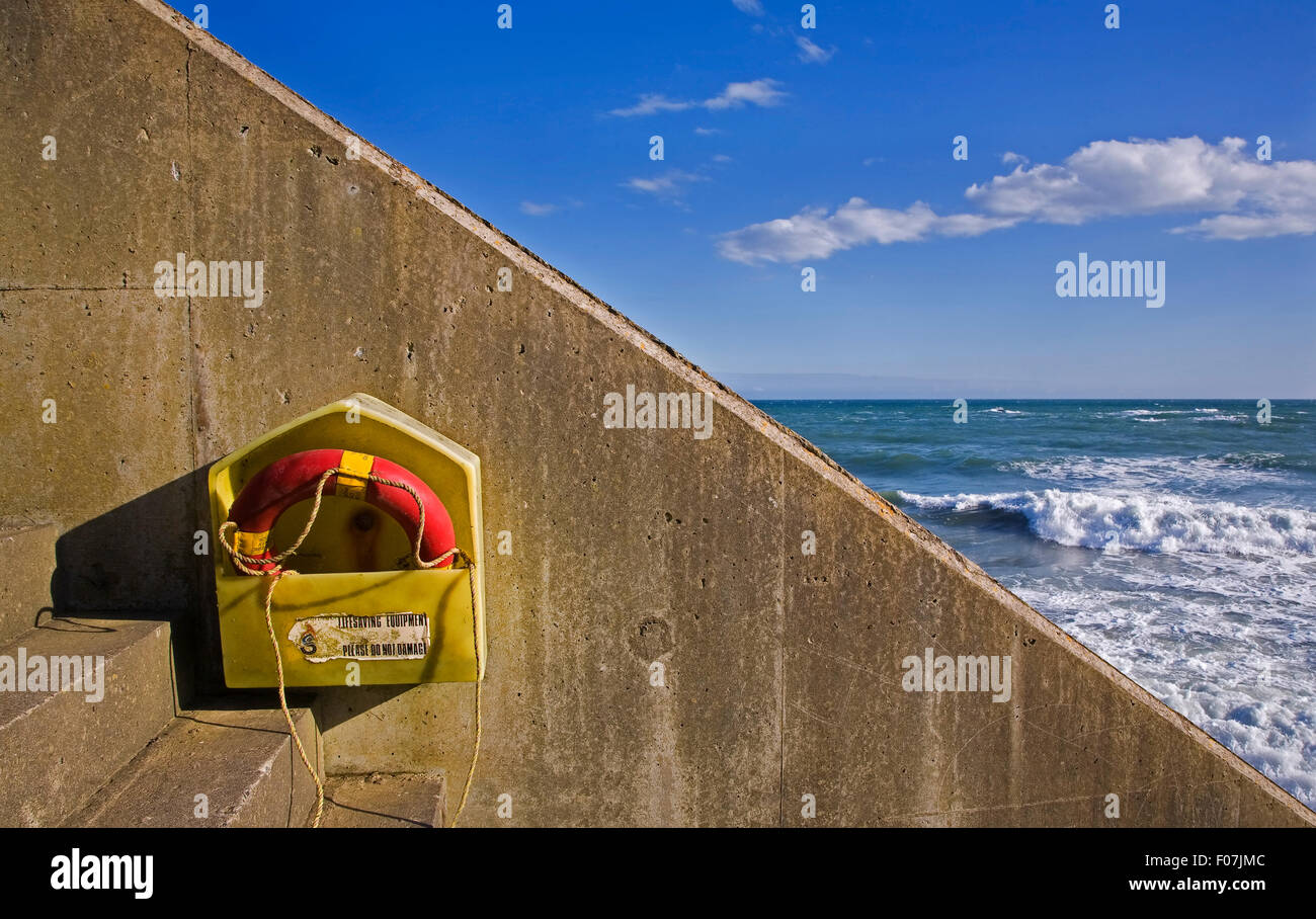 Lifebelt on steps down to the beach near Annestown, Copper Coast, Co Waterford, Ireland - Stock Image