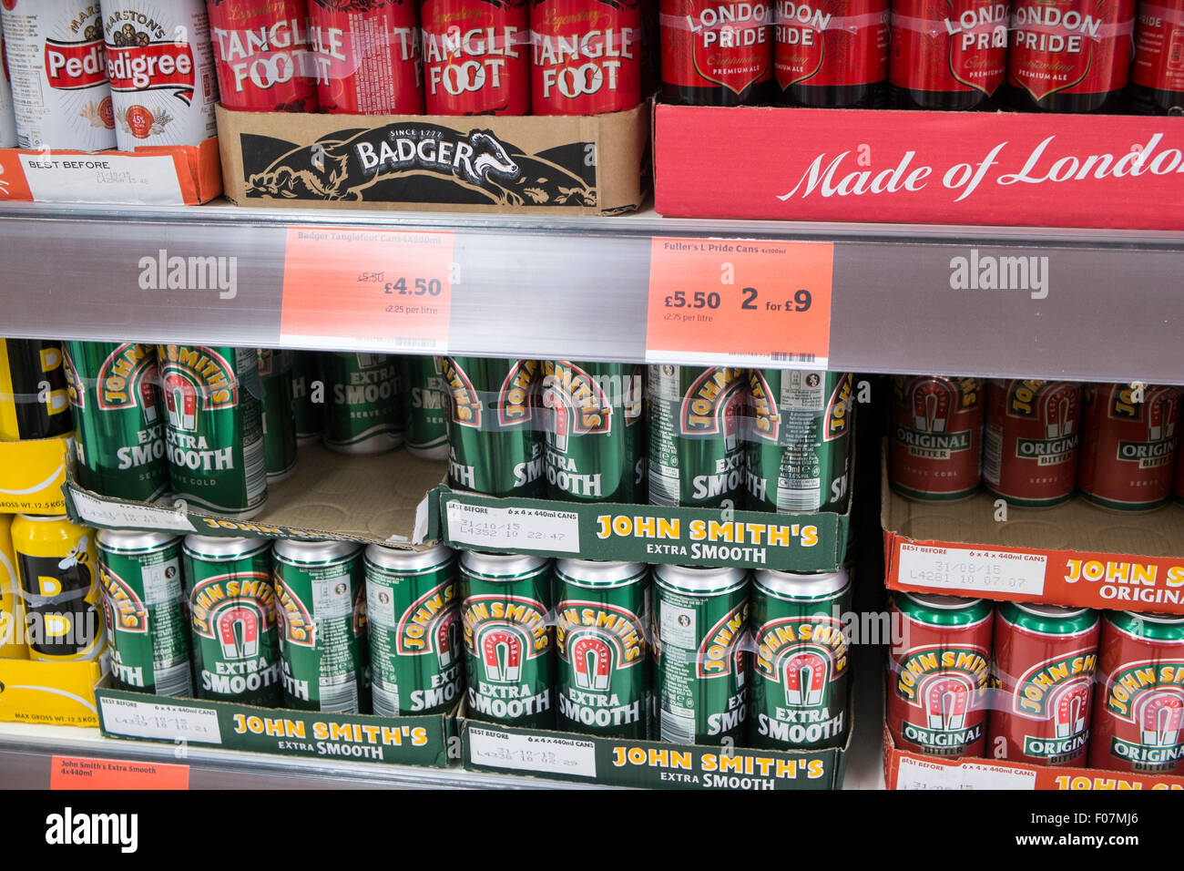 Sainsburys supermarket shelves in a store in Derbyshire,England showing english beers on sale including tangle foot - Stock Image