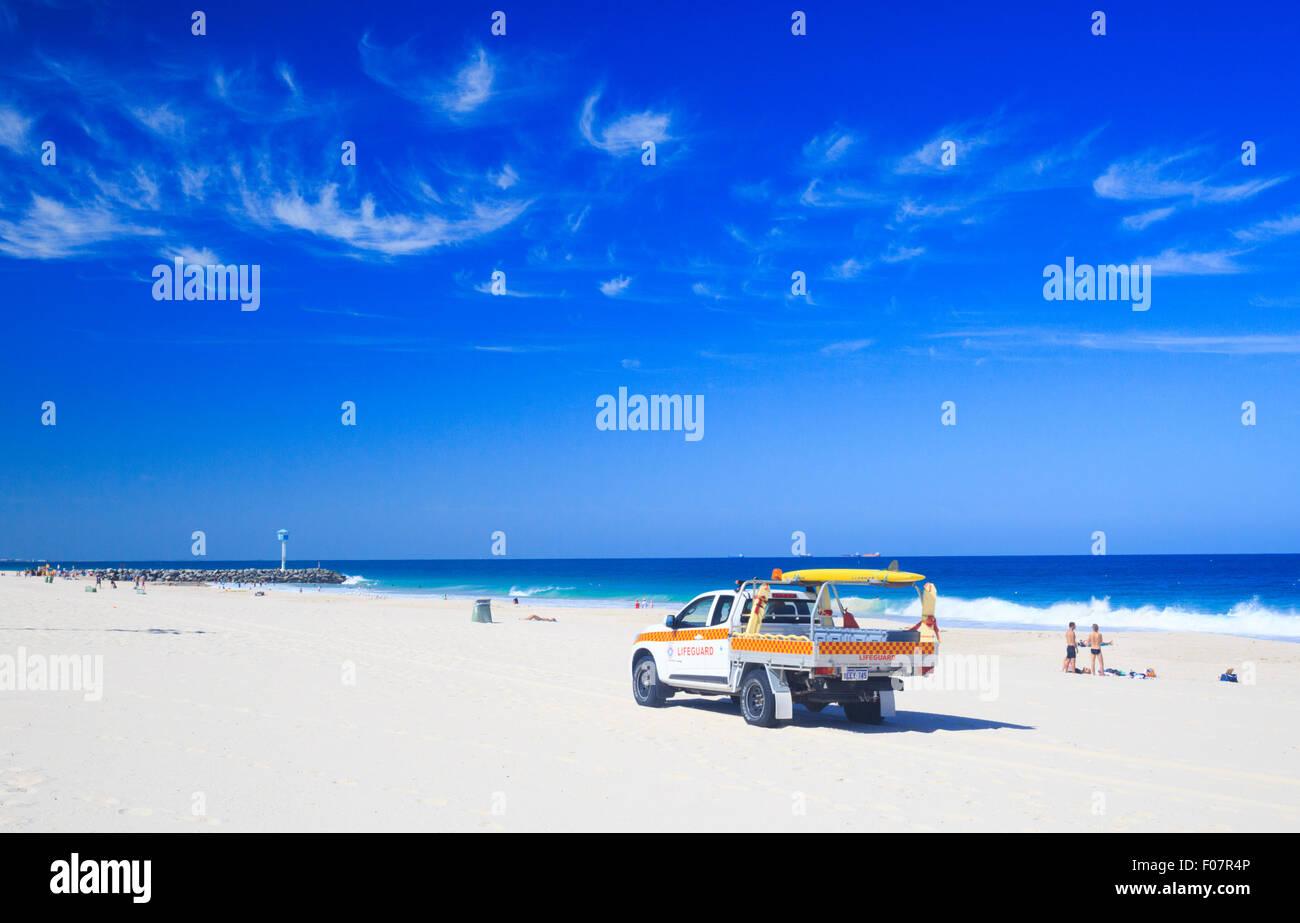 Australian Lifeguard Service 4WD vehicle patrolling the beach. City Beach, Perth, Western Australia - Stock Image