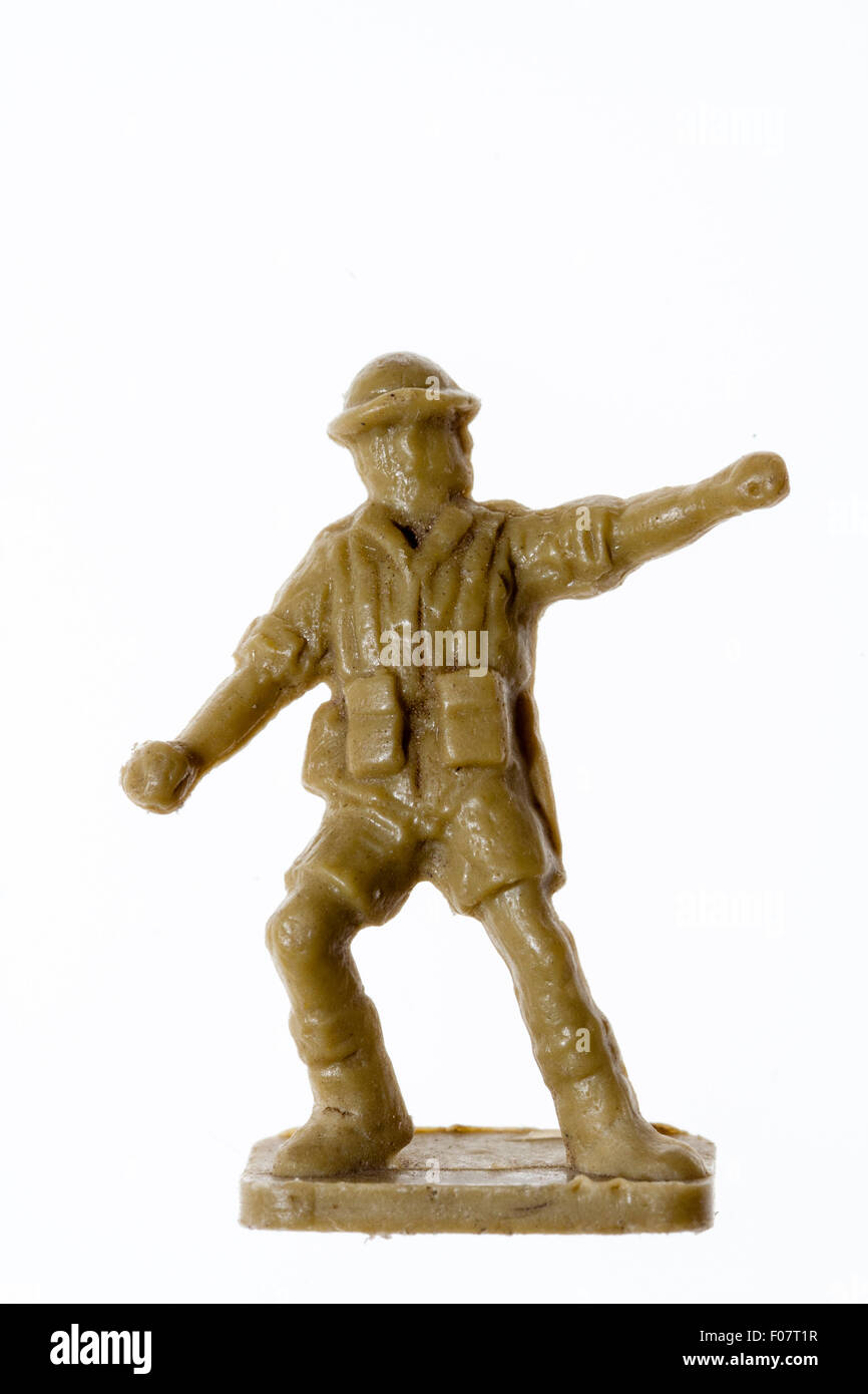 Airfix HO/OO plastic model soldier figure. World War Two, 8th army. Plain background. Standing throwing grenade - Stock Image