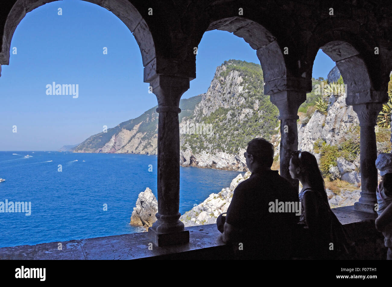 Ligurian coast through pilars of Church San Pietro at Portovenere Sea of Liguria Mediterranean Sea Italy - Stock Image