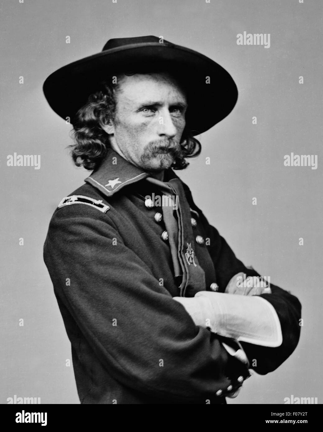 Brevet Major General George Armstrong Custer in field uniform circa 1865. Unattributed photograph. - Stock Image