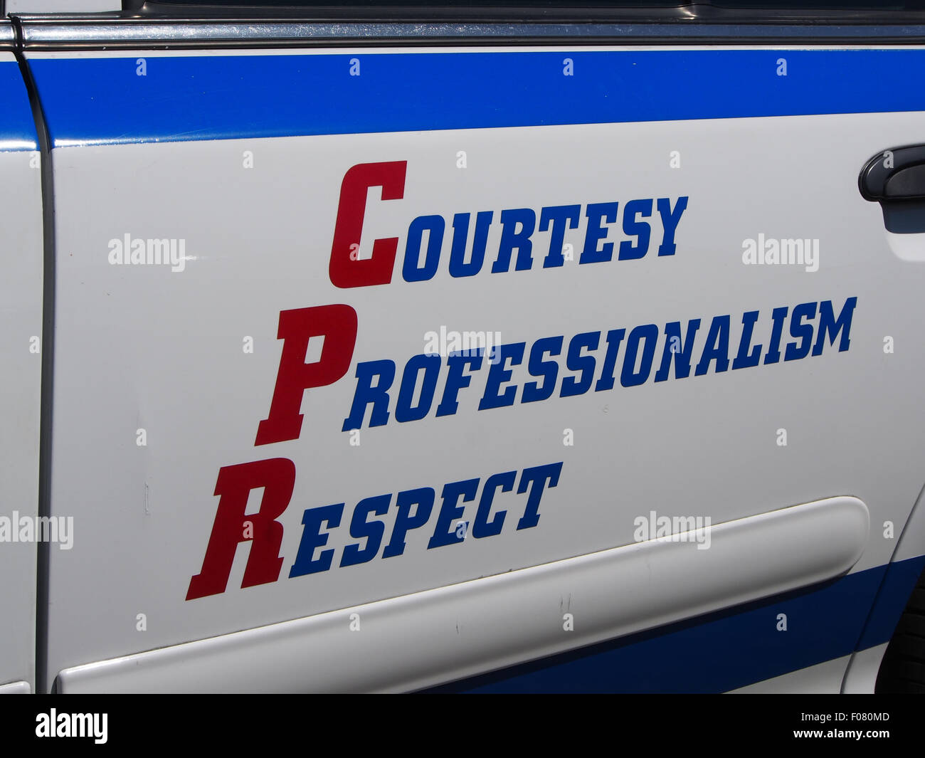 courtesy professionalism respect, the motto of the NYPD, on the side of a New York Police Department car - Stock Image