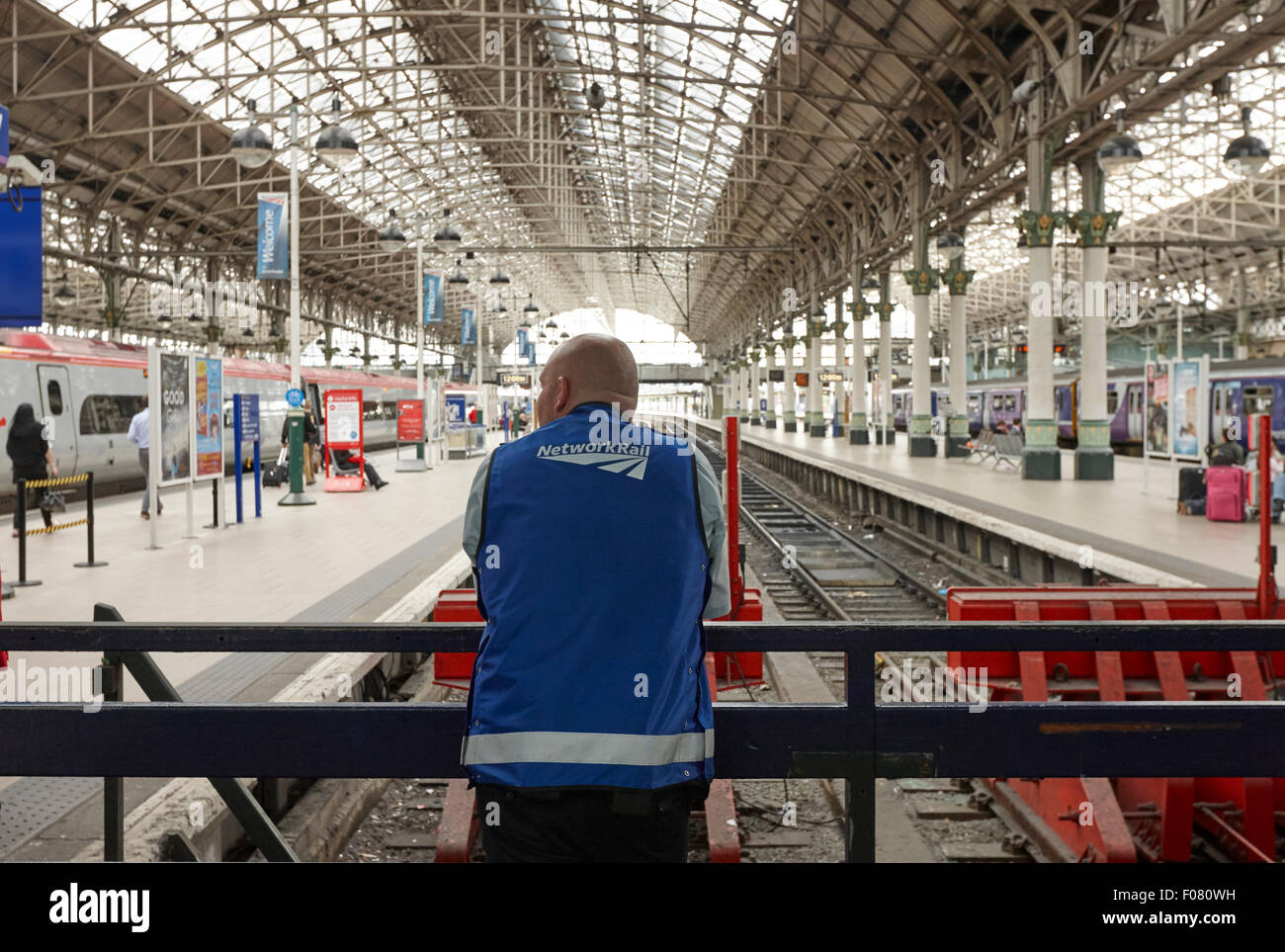network rail staff member at Piccadilly train station Manchester UK - Stock Image