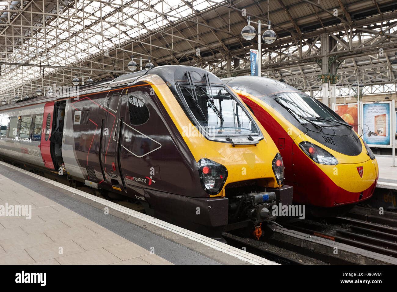 cross country and virgin trains at the platforms in Piccadilly train station Manchester UK - Stock Image