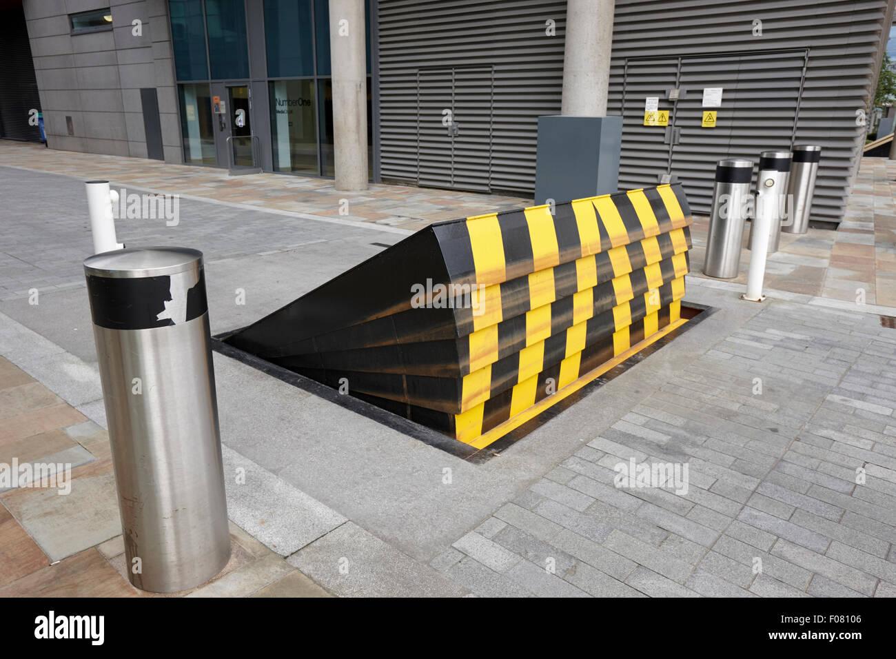 rising road blocker at mediacity salford Manchester uk - Stock Image
