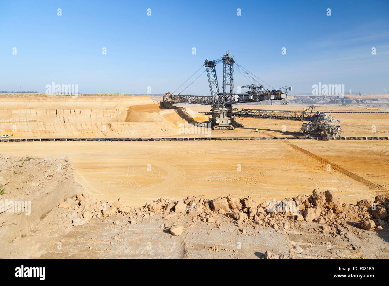 A giant Bucket Wheel Excavator at work in an endless lignite pit mine Stock Photo