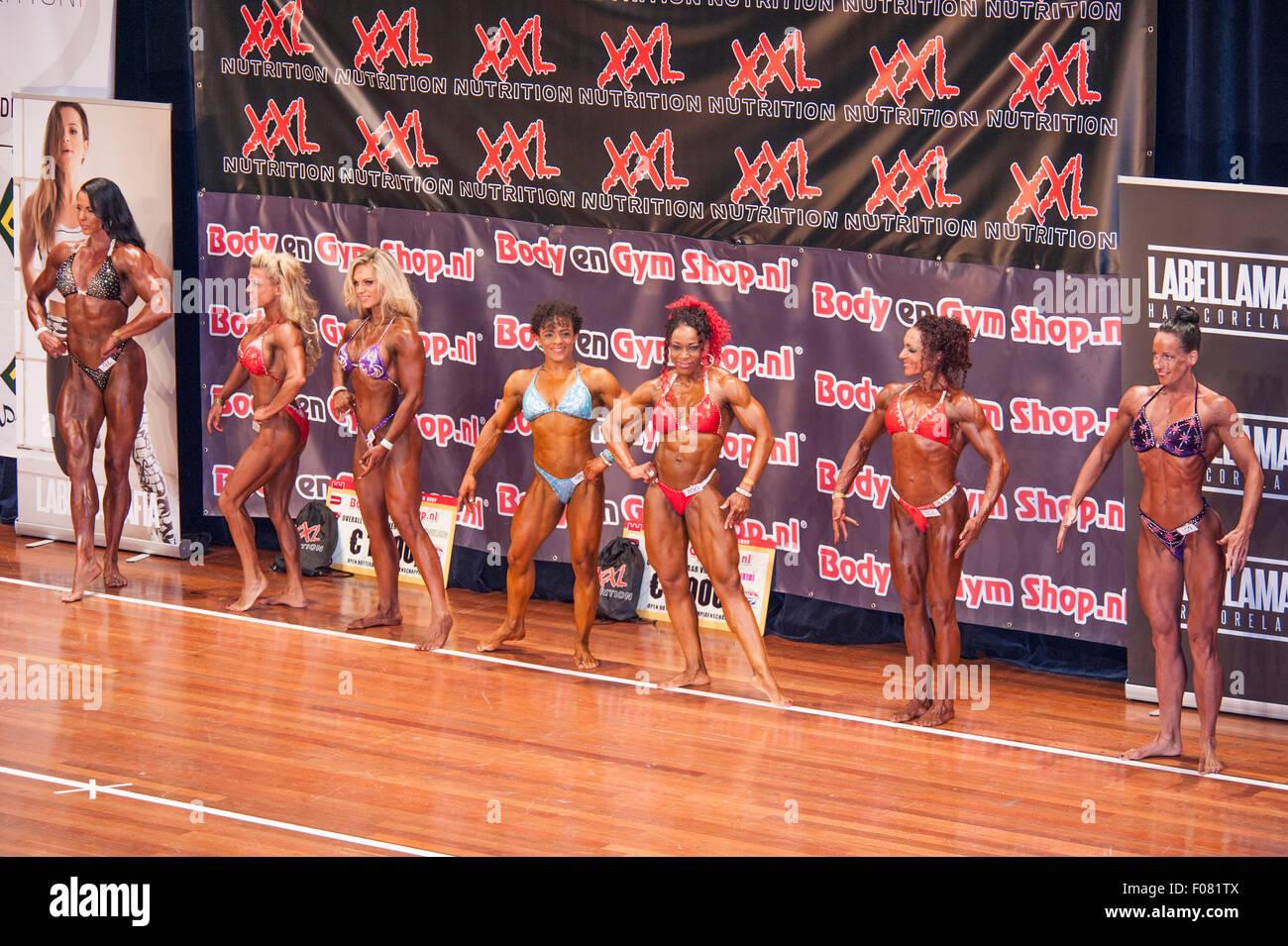 SCHIEDAM, THE NETHERLANDS - APRIL 26, 2015: Female bodybuilders Naima Benamari, Mariska Meuissen in a lineup comparison - Stock Image