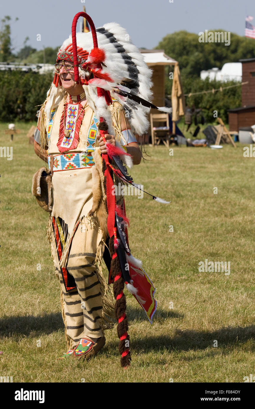 Man dressed as a Native American Indian chieftain - Stock Image