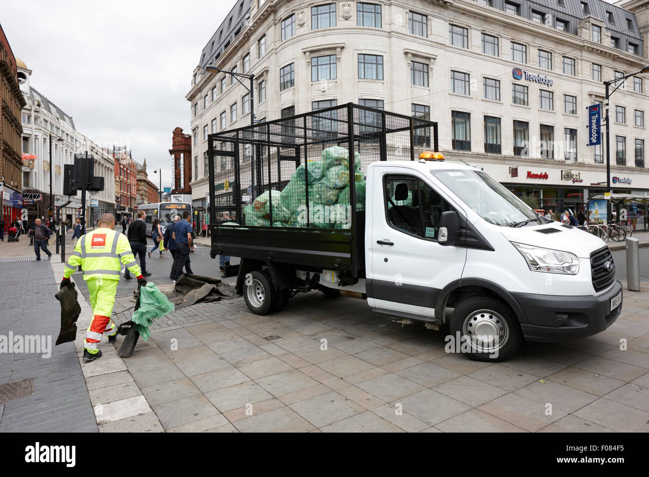 refuse cleaners tidying up piccadilly square Manchester England UK - Stock Image