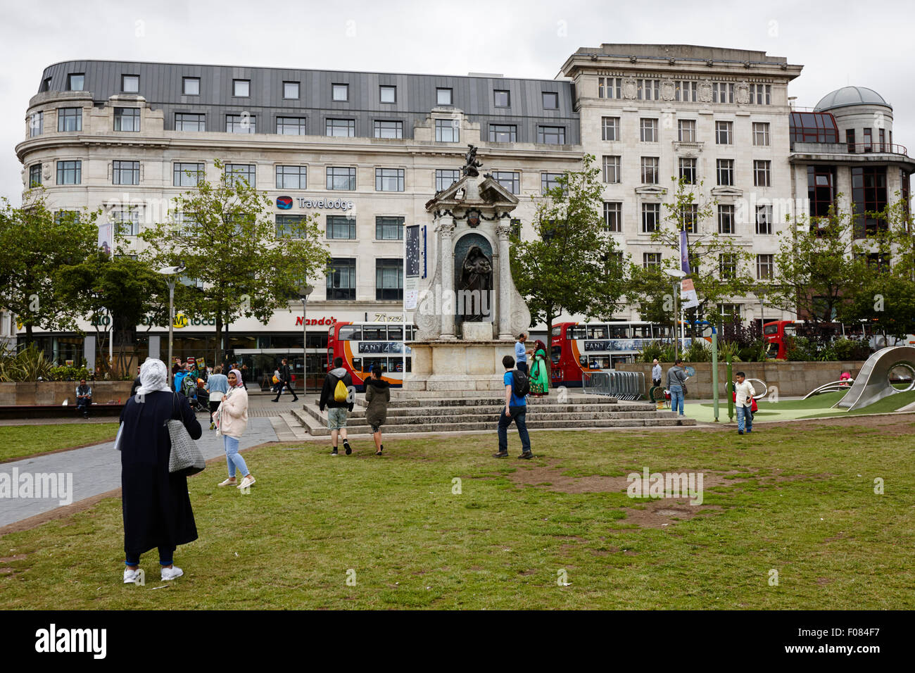 people in Piccadilly gardens Manchester England UK - Stock Image