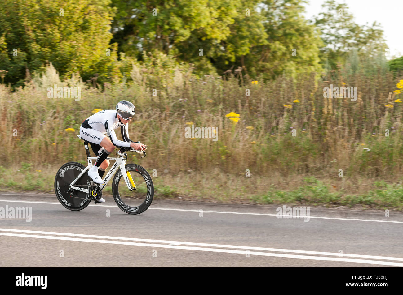 TT time trial cycling pairs on Brands Hatch road dedicated gear equipment bikes and streamlined on very fast road - Stock Image