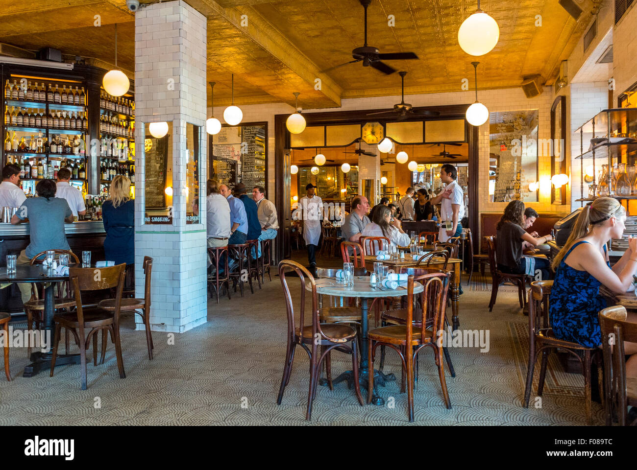 New York City, USA, Meat Packing District, People Sharing Meals in Traditional French Bistro Restaurant Dining Room, Stock Photo