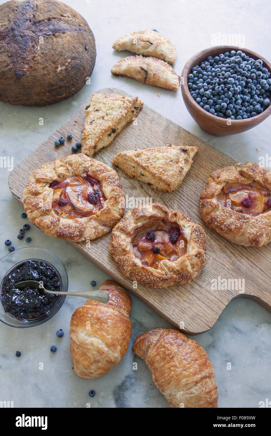 variety of morning fresh baked goods for breakfast - Stock Image