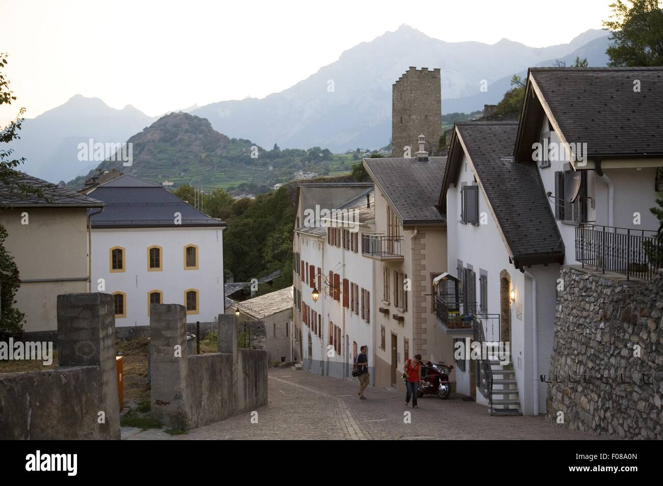 Passers by walking near street castles at Sion, Valias, Switzerland - Stock Image