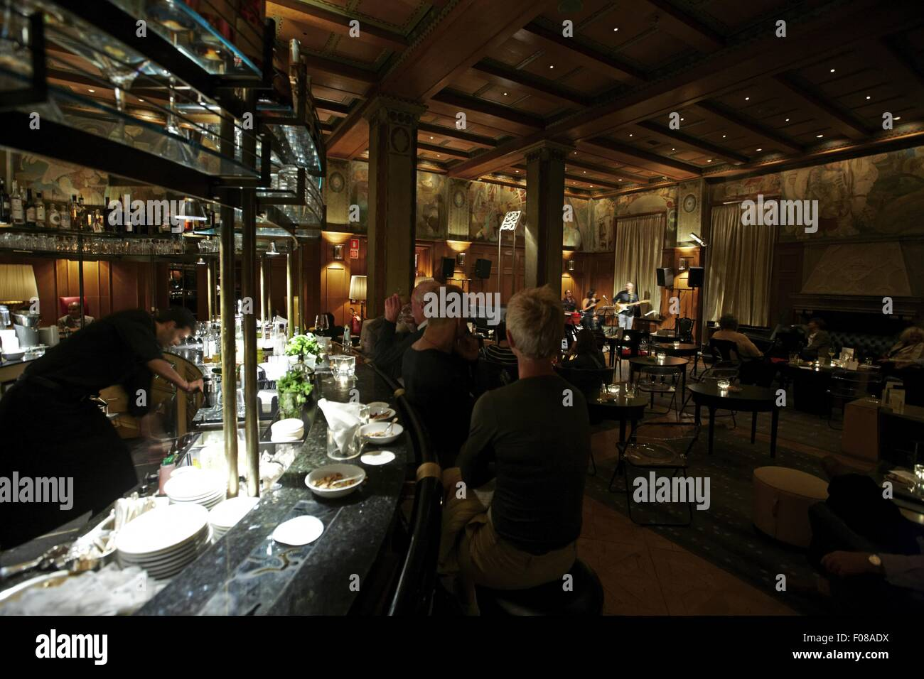 View of people in bar Laurin while jazz band in background at Bolzano, Italy - Stock Image