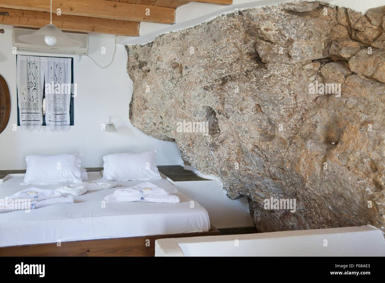 Bedroom With Rock Wall Of Hotel Porto In Loutro Crete Greece Stock Photo Alamy