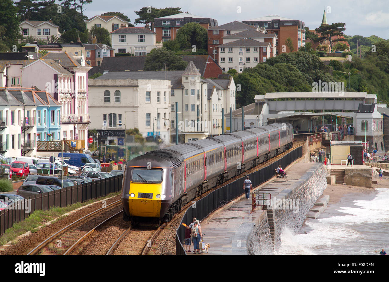Cross Country HST passes along the famous sea wall at Dawlish - Stock Image