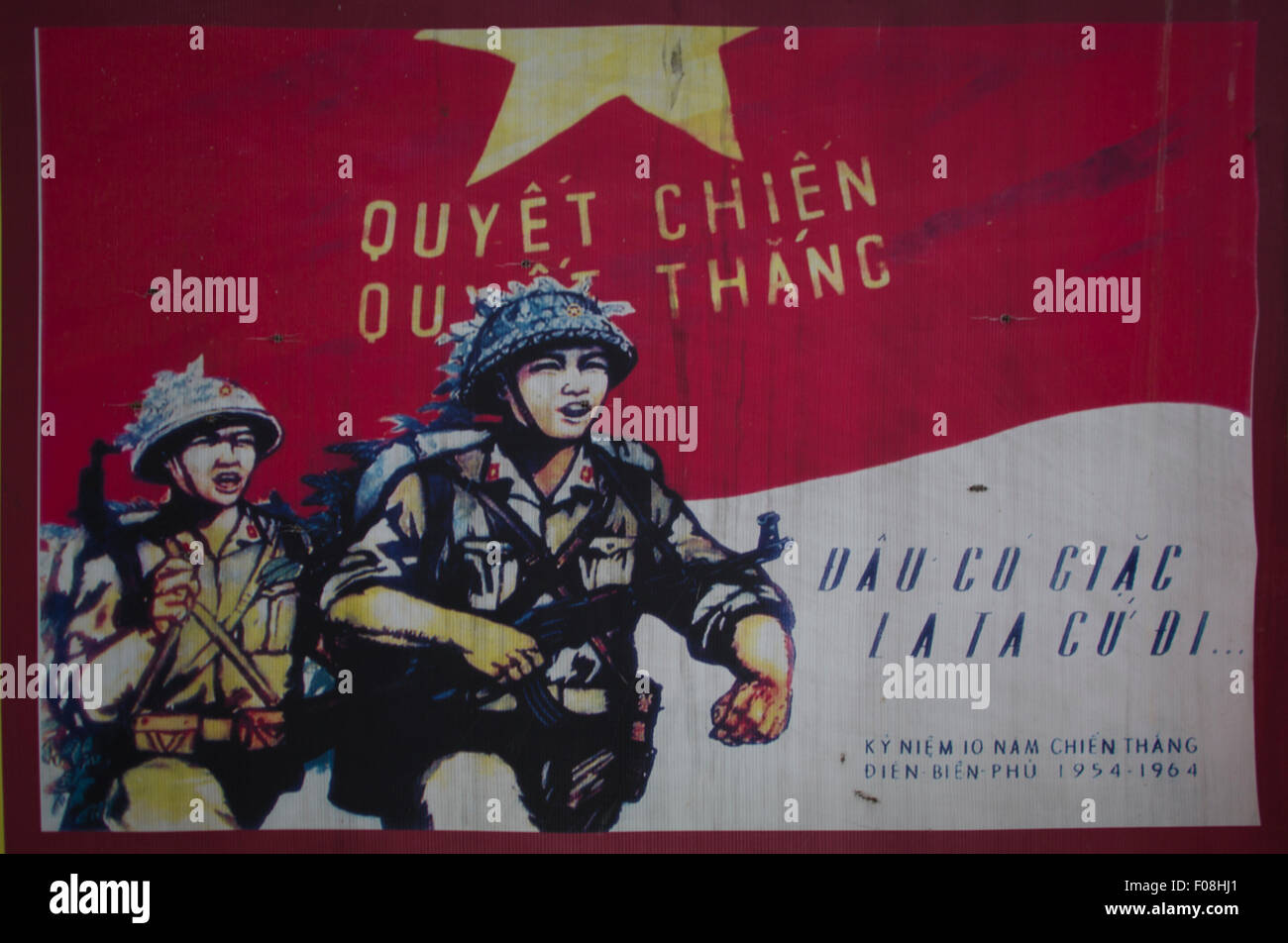 old propaganda poster showing vietcong soldiers - Stock Image