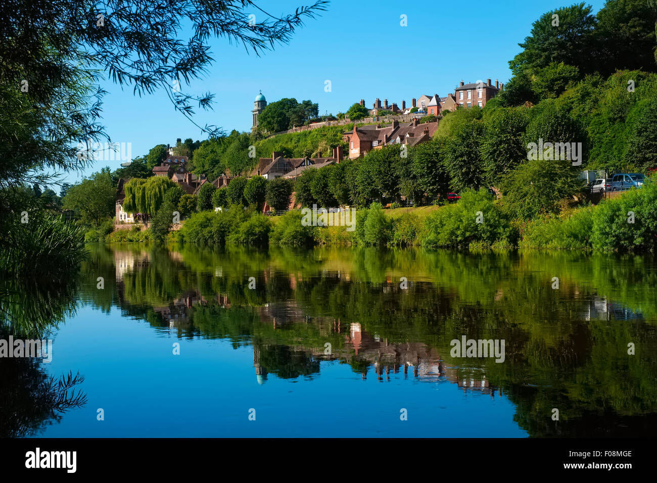 The Shropshire town of Bridgnorth reflected in the River Severn. - Stock Image