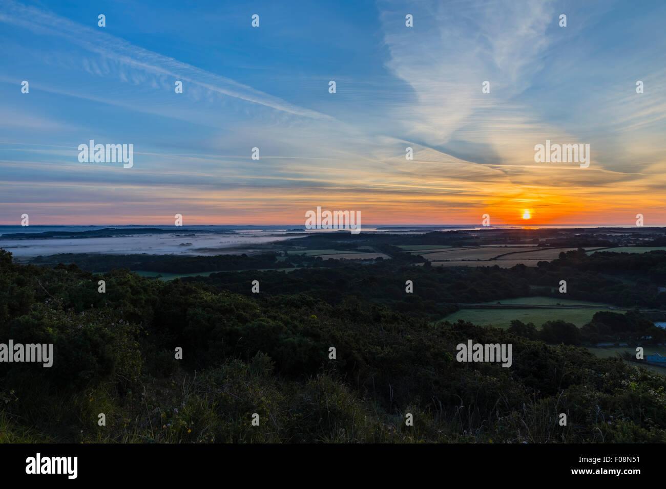 Sunrise over the Dorset countryside from near Corfe Castle, Isle of Purbeck, Dorset, England, United KingdomStock Photo