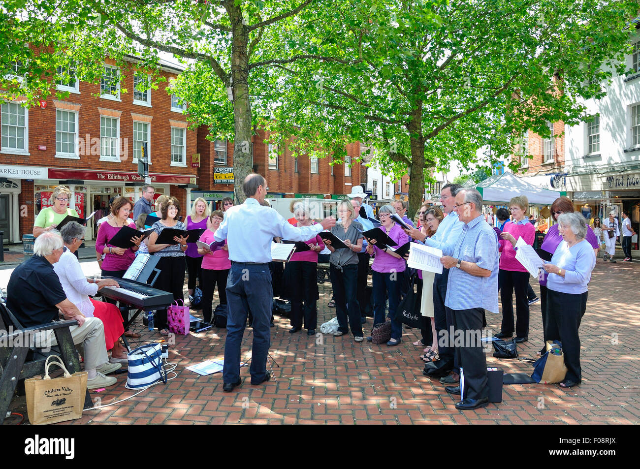 Local choir singing in Market Place, Wokingham, Berkshire, England, United Kingdom - Stock Image