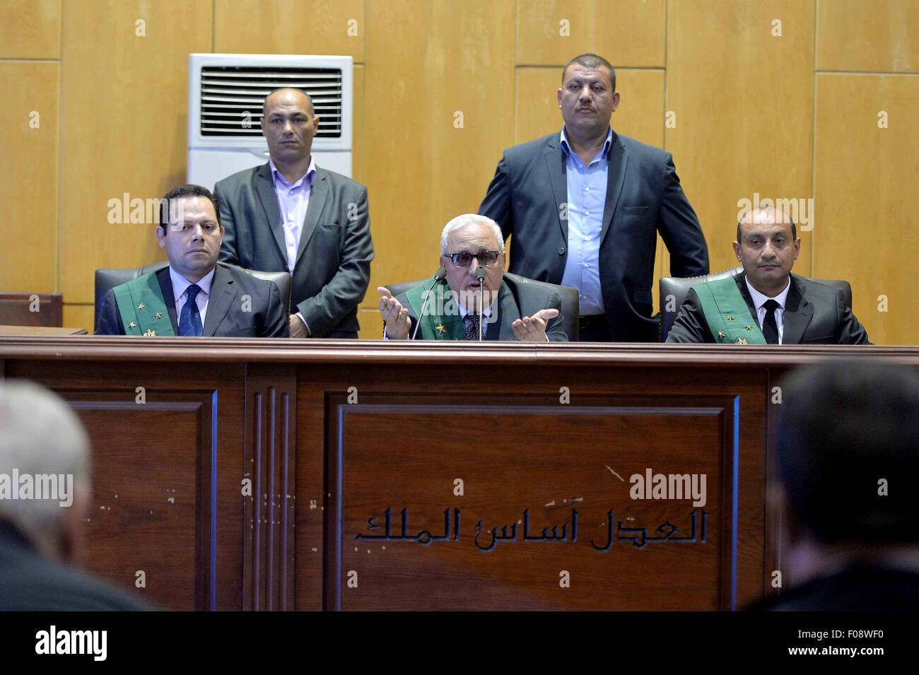 Cairo, Egypt. 9th Aug, 2015. The Judge attend the trial of Egyptian defendants over a 2012 stadium riot in the canal Stock Photo