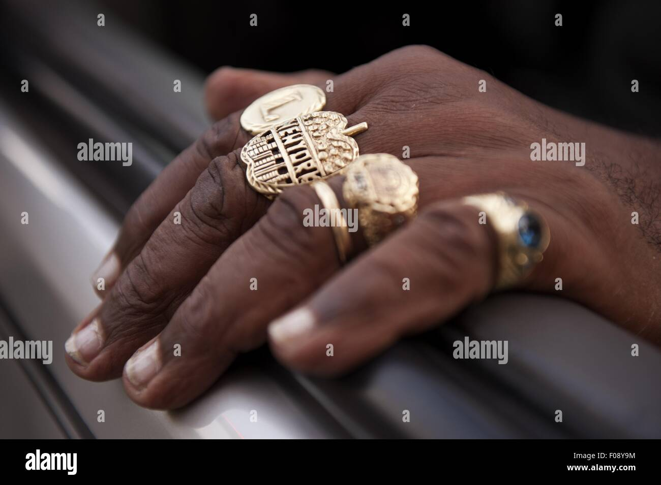 Close Up Of Manu0027s Hand Wearing Gold Rings In New York, USA