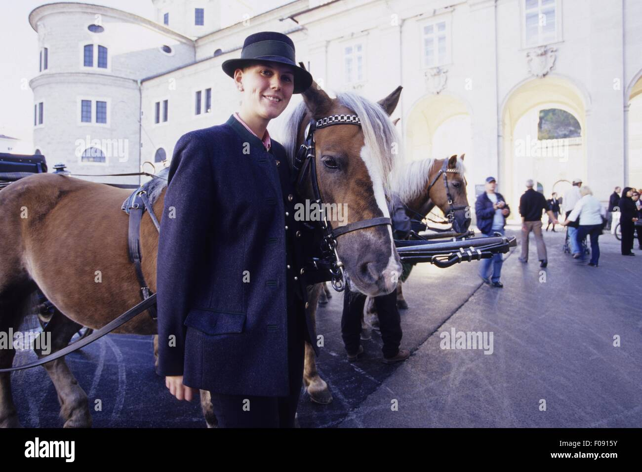 Woman standing besides horse at Cathedral Square, Salzburg, Austria - Stock Image