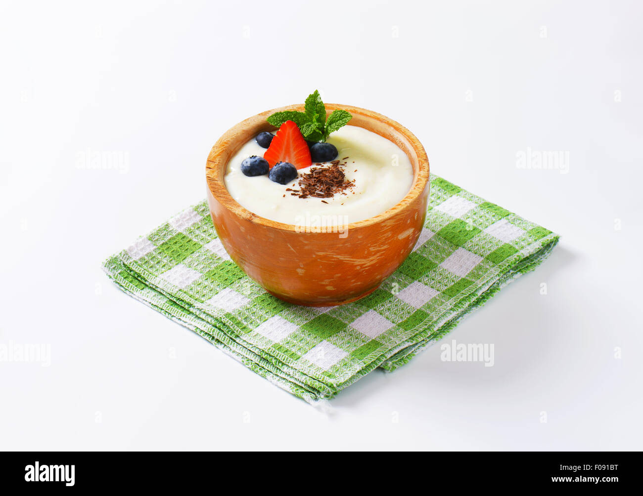 Smooth semolina porridge served with fresh fruit and grated chocolate - Stock Image