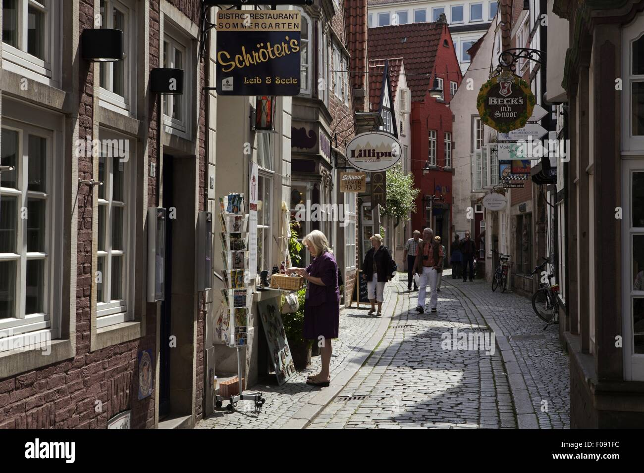view of people on schnoor street shop in viertel bremen germany stock photo 86250624 alamy. Black Bedroom Furniture Sets. Home Design Ideas