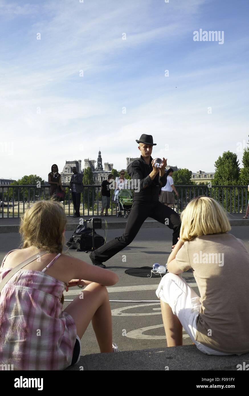 Juggler performing on Pont Saint-Louis bridge in Paris, France Stock Photo