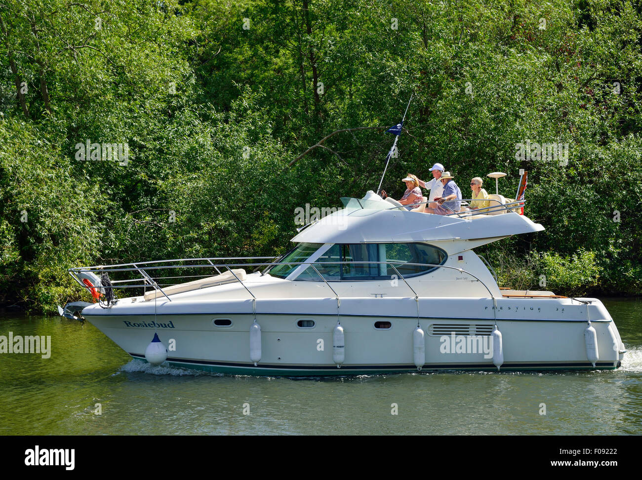 Group on Jeanneau Prestige 32 Boat cruise boat on River Thames, Runnymede, Surrey, England, United Kingdom - Stock Image