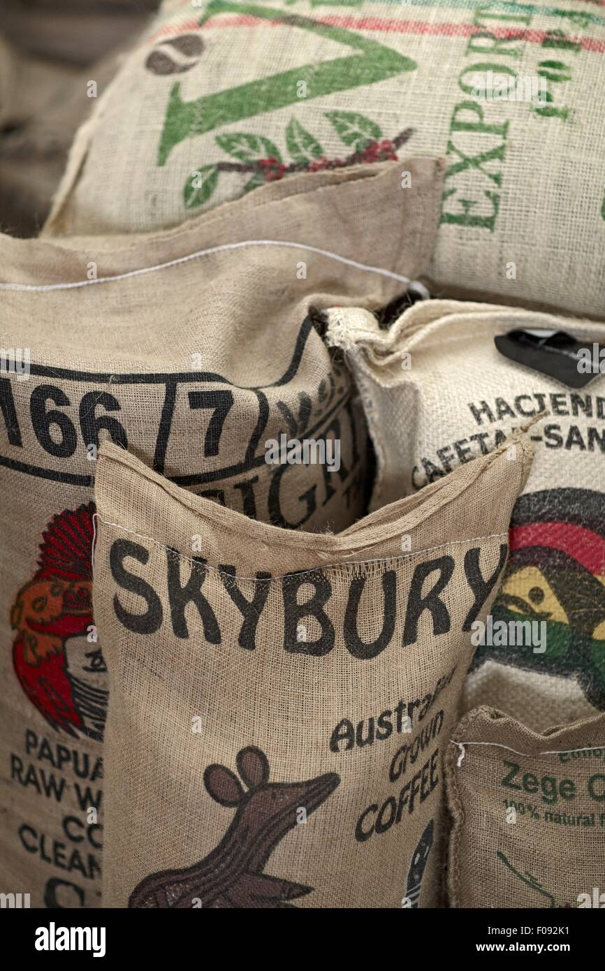 Close-up of sacks of raw coffee beans - Stock Image