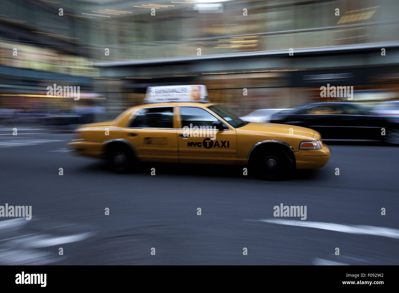 Taxi on road of New York, Blurred motion - Stock Image