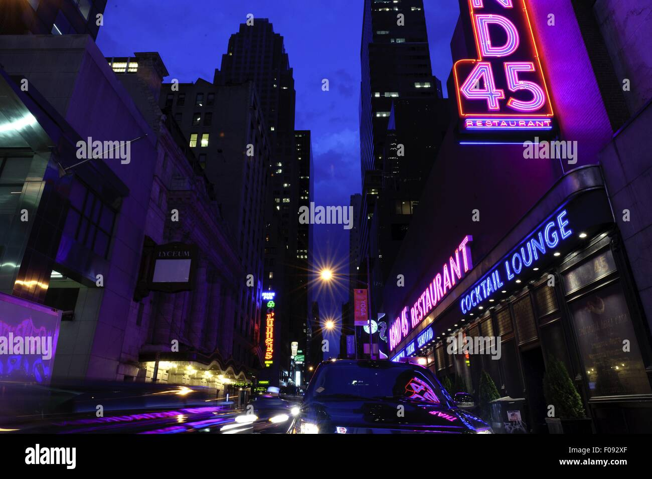 Neon signboards at Times Square at night, New York, USA - Stock Image